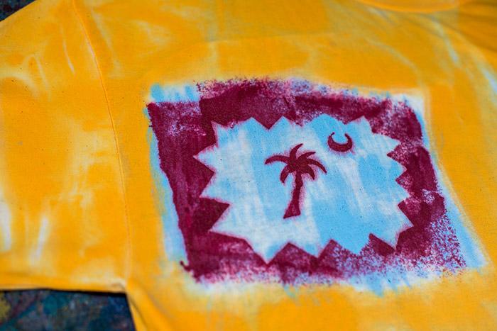 A vibrant shirt-of-art at the Sloop Jones workshop!